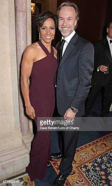 Dame Kelly Holmes and Marcus Wareing attend the Lotsofcharity.com Remarkable dinner at the St Pancras Renaissance Hotel on April 29, 2015 in London,...