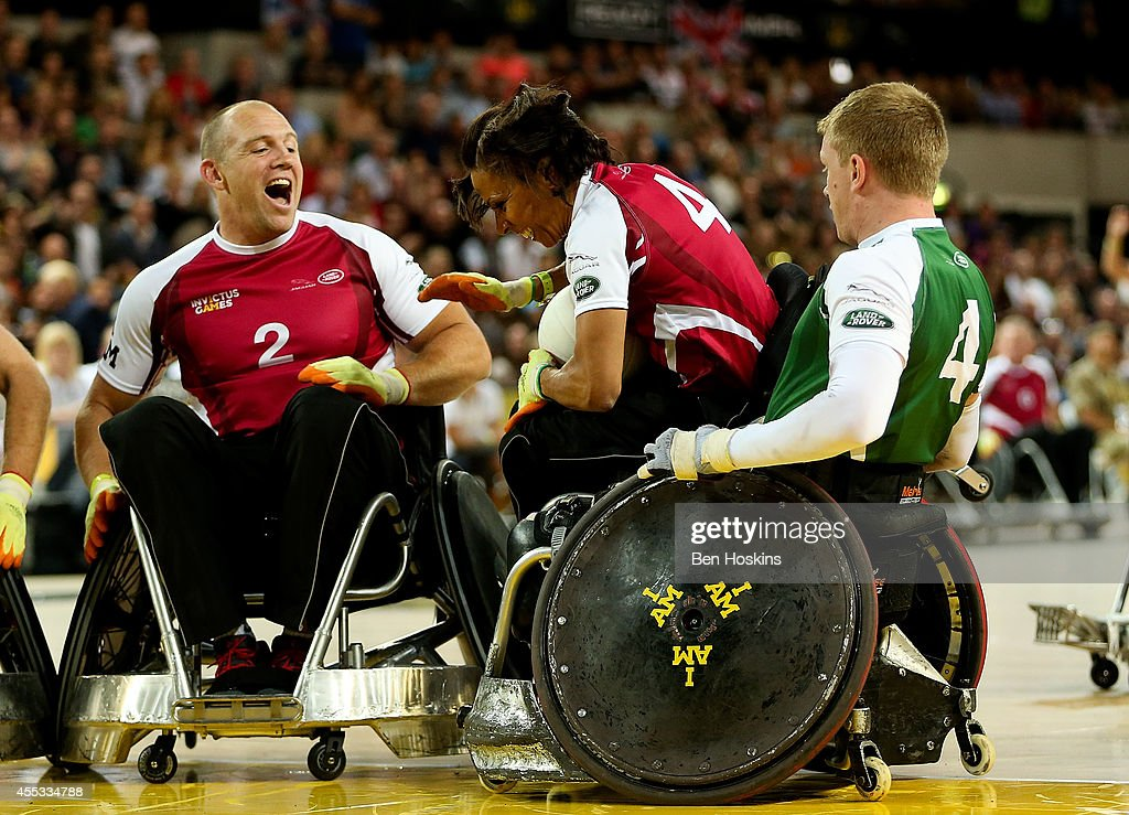 Dame Kelly Holmes of team Endeavour is tackled by James Roberts of team Invictus during Day Two of the Invictus Games at Olympic Park on September 12, 2014 in London, England.