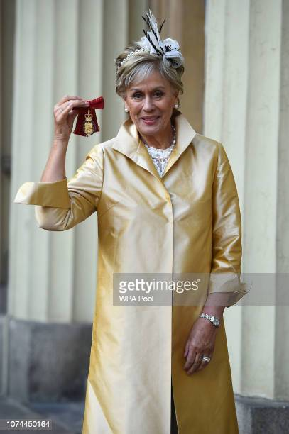 Dame Kiri Te Kanawa with her Order of the Companions of Honour presented to her by the Prince of Wales during an investiture ceremony on December 20...