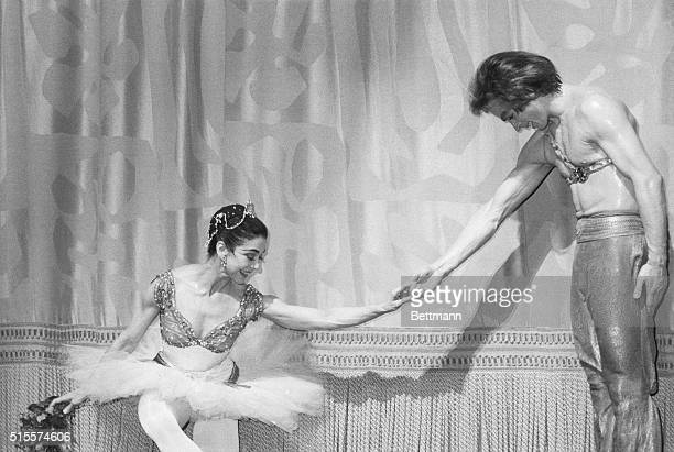 Dame Margot Fonteyn and Rudolf Nureyev acknowledge applause during a curtain call after a gala performance of the Royal Ballet at the Metropolitan...