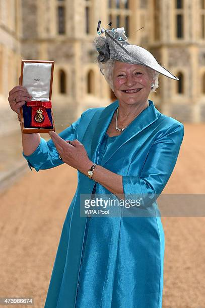 Dame Mary Peters holds her insignia of member of the Order of the Companions of Honour services to Sport and to the community in Northern Ireland at...