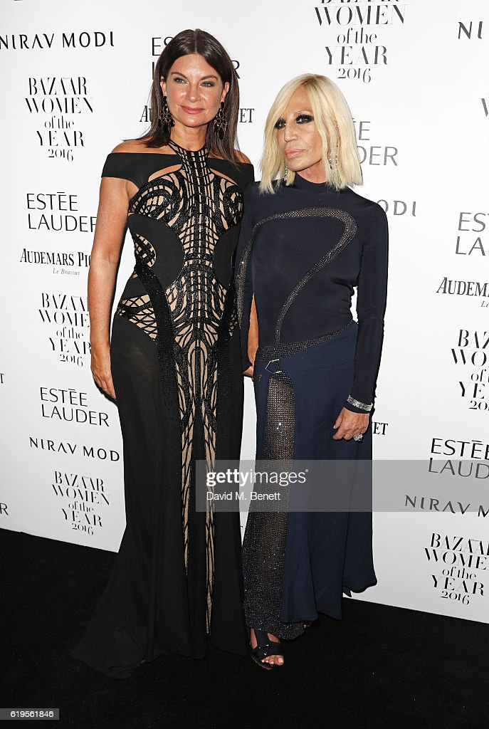 Dame Natalie Massenet (L) and Donatella Versace attend the Harper's Bazaar Women of the Year Awards 2016 at Claridge's Hotel on October 31, 2016 in London, England.