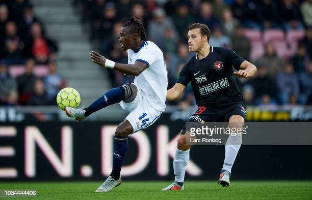 Dame N'Doye of FC Copenhagen and Erik Sviatchenko of FC Midtjylland compete for the ball during the Danish Superliga match between FC Midtjylland and...