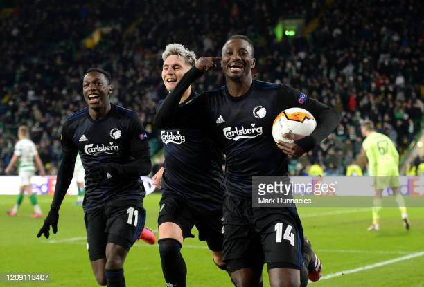 Dame N'Doye of FC Copenhagen celebrates after scoring his sides third goal during the UEFA Europa League round of 32 second leg match between Celtic...
