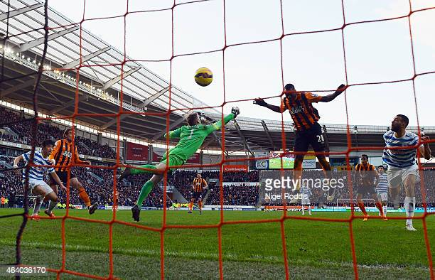 Dame N'Doye of Hull City beats goalkeeper Robert Green of QPR to score their second goal during the Barclays Premier League match between Hull City...