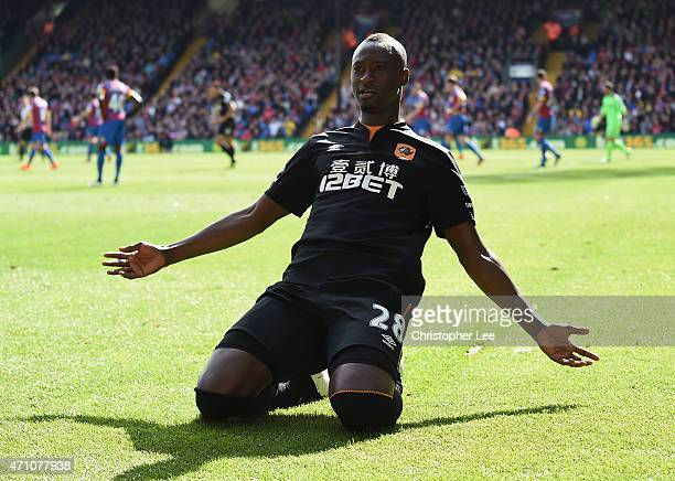 Dame N'Doye of Hull City celebrates scoring the opening goal during the Barclays Premier League match between Crystal Palace and Hull City at...