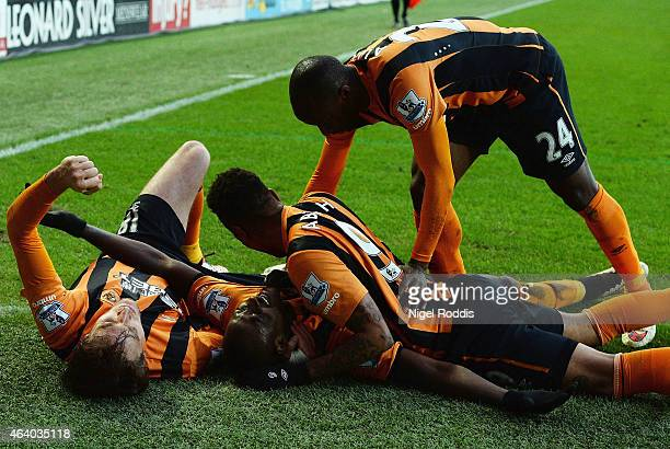 Dame N'Doye of Hull City celebrates with team mates as he scores their second goal during the Barclays Premier League match between Hull City and...