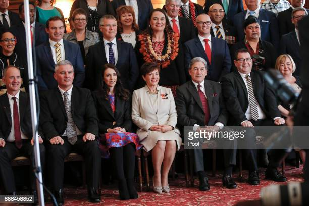 Dame Patsy Reddy GovernorGeneral of New Zealand Prime Minister Jacinda Ardern Deputy Prime Minister Winston Peters Ministers pose during a swearingin...