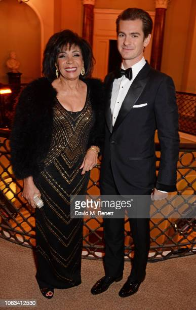Dame Shirley Bassey and Andrew Garfield attend The 64th Evening Standard Theatre Awards at the Theatre Royal Drury Lane on November 18 2018 in London...