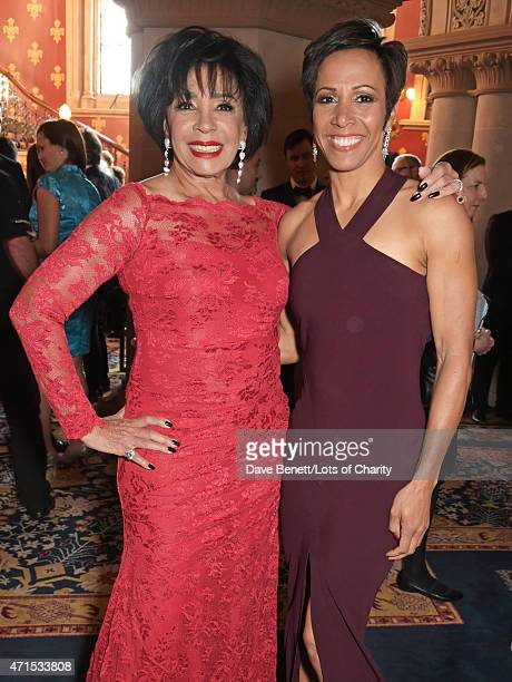 Dame Shirley Bassey and Dame Kelly Holmes attend the Lotsofcharity.com Remarkable dinner at the St Pancras Renaissance Hotel on April 29, 2015 in...