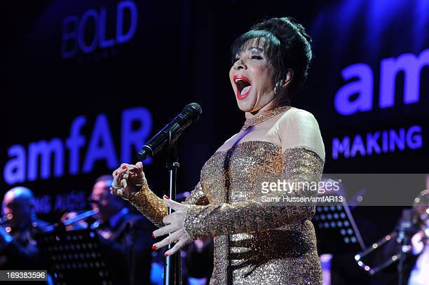Dame Shirley Bassey performs on stage at amfAR's 20th Annual Cinema Against AIDS during The 66th Annual Cannes Film Festival at Hotel du CapEdenRoc...