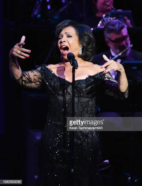 Dame Shirley Bassey performs onstage at amfAR Los Angeles 2018 at Wallis Annenberg Center for the Performing Arts on October 18 2018 in Beverly Hills...