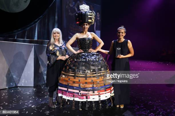 Dame Suzie Moncrieff poses with Annina Gull of Switzerland and her creation '222 Buckle Belts' after winning Dame Suzie Moncrieff Award during the...