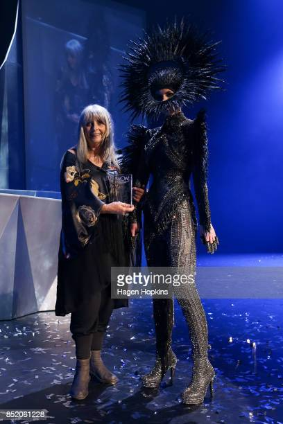 Dame Suzie Moncrieff poses with 'Cosmos' by Rinaldy Yunardi of Indonesia after winning the Avantgarde Section Award during the World of WearableArt...