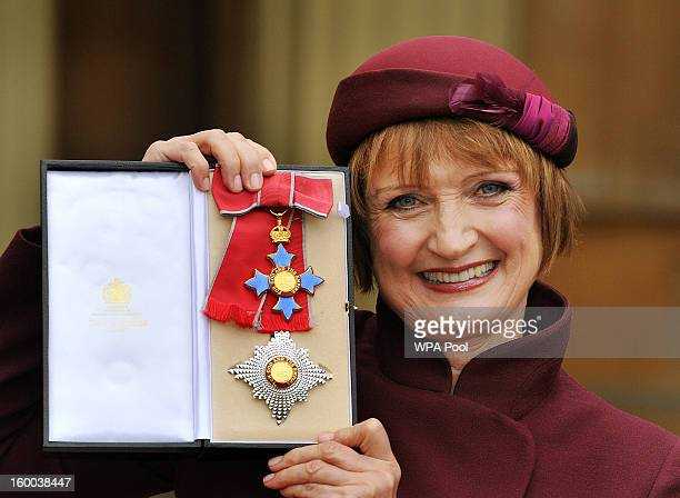 Dame Tessa Jowell proudly holds her Dame Commander insignia after it was presented to her by the Prince of Wales during the Investiture ceremony at...