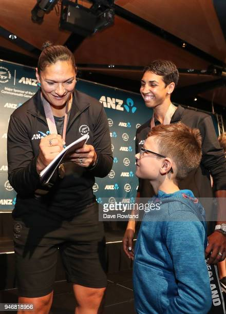 Dame Valerie Adams silver medal for shot put and Alexis Pritchard bronze medal for boxing sign autographs during the Welcome Home Function at Novotel...