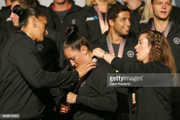 Dame Valerie Adams silver medal for shot put checks the medals of Sophie Pascoe gold medals for swimming helped by Julia Ratcliffe gold medal for...
