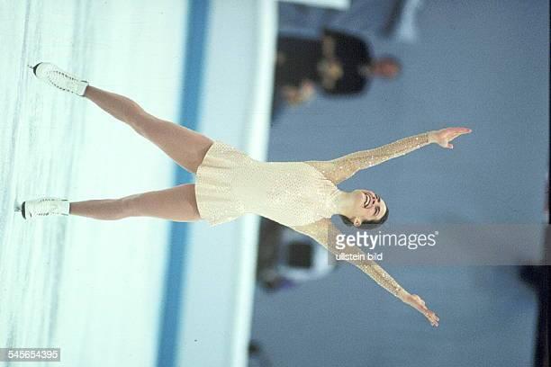Nancy Kerrigan am Endeihrer Kür mit nach oben gestreckten Armen