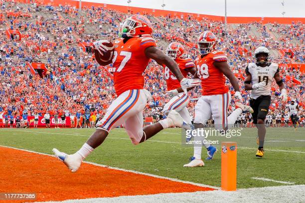 Dameon Pierce of the Florida Gators scores a touchdown during the third quarter against the Towson Tigers at Ben Hill Griffin Stadium on September...