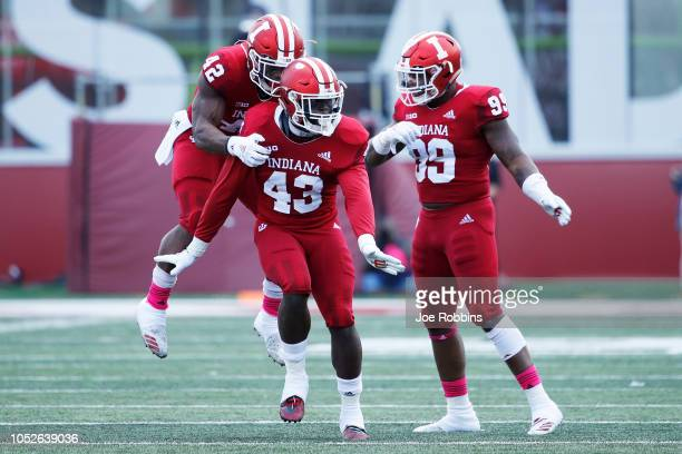 Dameon Willis Jr #43 of the Indiana Hoosiers celebrates with Marcelino Ball and Allen Stallings IV after a defensive stop against the Penn State...