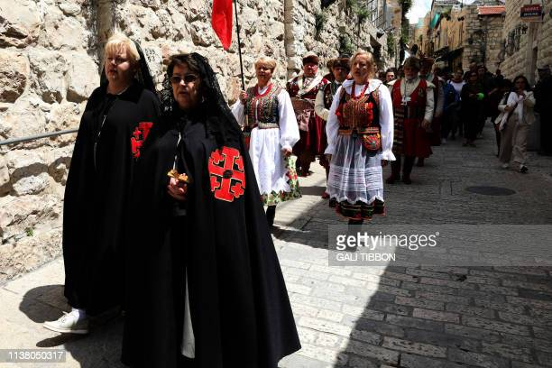 Dames of the order of the Knights of the Holy Sepulchre walk along the Via Dolorosa in Jerusalem's Old City during the Good Friday procession on...