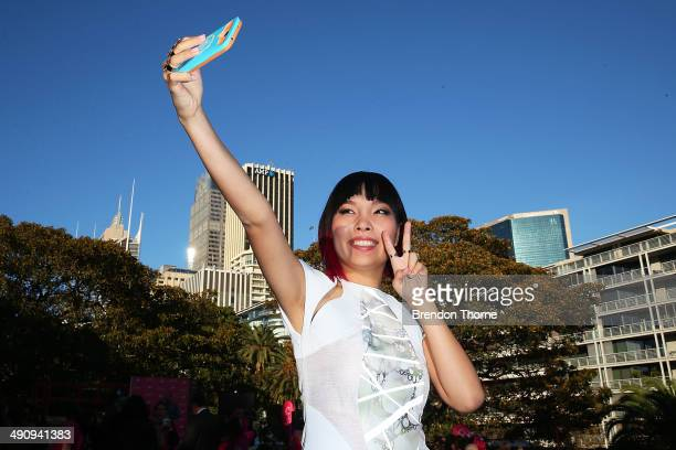 Dami Im poses for a 'selfie' during a world record attempt at the longest selfie during a 'You Beauty' campaign consumer event at the Botanical...