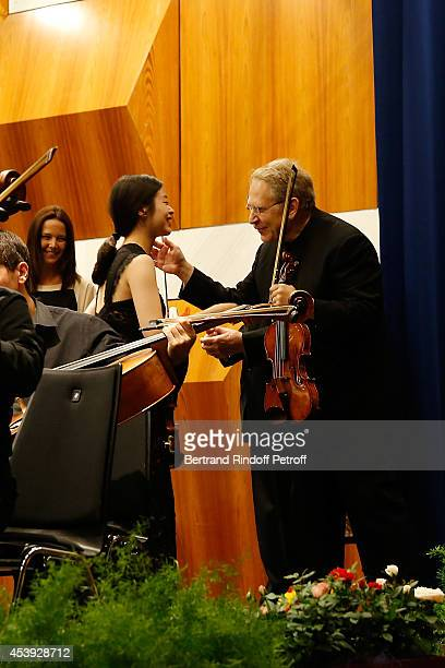 Dami Kim receive a Price by Jean Bonvin and Shlomo Mintz during the concert of close of the Summer season on August 16 2014 in CransMontana...
