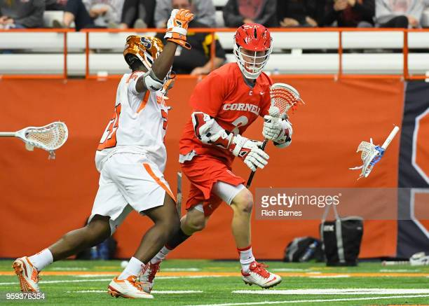 Dami Oladunmoye of the Syracuse Orange breaks his stick while defending Jonathan Donville of the Cornell Big Red during a 2018 NCAA Division I Men's...