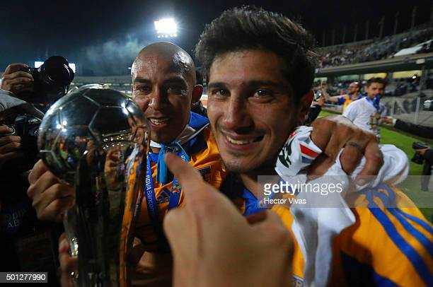 Damian Alvarez and Egidio Arevalo hold the champions trophy after the final second leg match between Pumas UNAM and Tigres UANL as part of the...
