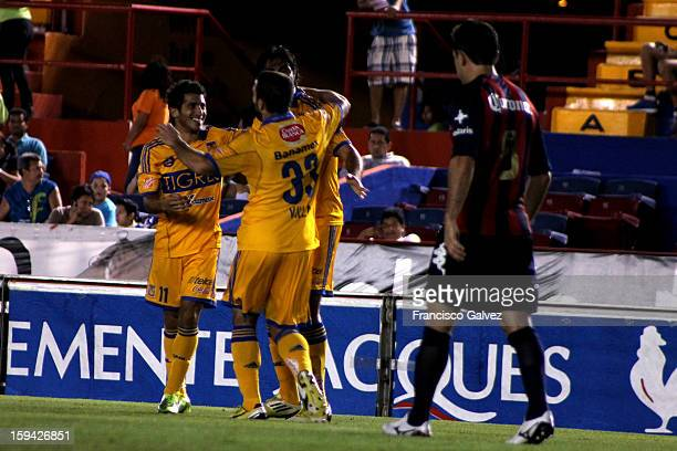 Damian Alvarez and Emanuel Villa of Tigres celebrates a goal during a match between Atlante and Tigres as part of the Torneo Clausura 2013 at Andres...