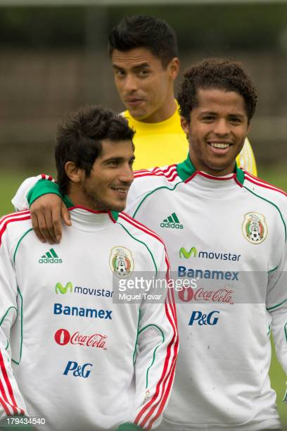 Damian Alvarez and Giovani Dos Santos attend a training session before a World Cup qualifier match against Honduras on September 03 2013 in Mexico...