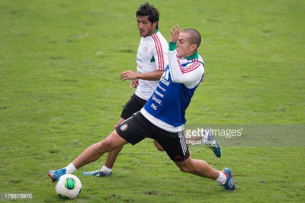 Damian Alvarez fights for the ball with Jorge Torres Nilo during a training session before a World Cup qualifier match against Honduras on September...