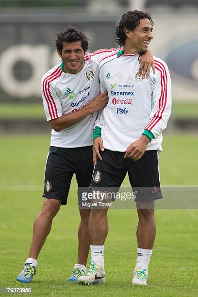 Damian Alvarez jokes with Fernando Arce during a training session before a World Cup qualifier match against Honduras on September 02 2013 in Mexico...