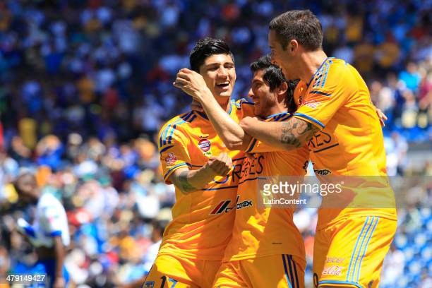 Damia‡n Alvarez of Tigres and teammates celebrate his goal during a match between Puebla and Tigres UANL as part of the 11th round Clausura 2014 Liga...