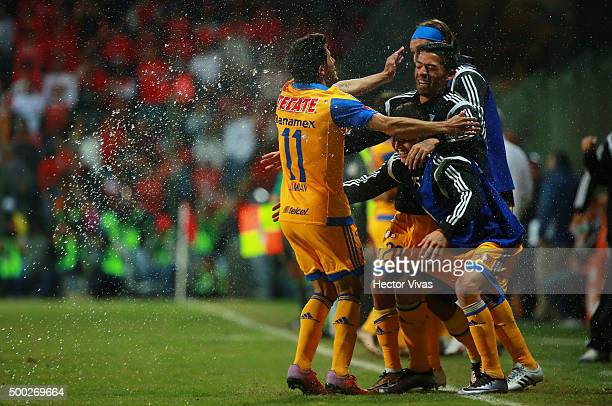 Damian Alvarez of Tigres celebrate with teammates after scoring the second goal of his team during the semifinals second leg match between Toluca and...