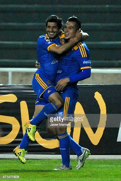 Damian Alvarez of Tigres celebrates with Enrique Esqueda after scoring his team's second goal during a first leg match between Universitario Sucre...