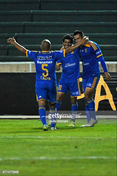 Damian Alvarez of Tigres celebrates with Enrique Esqueda and Egidio Arévalo Ríos after scoring his team's second goal during a first leg match...