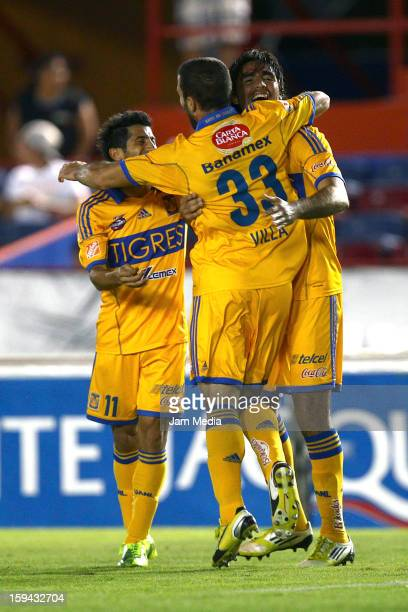 Damian Alvarez of Tigres celebrates with teammates a scored goal against Atlante during a match as part of the Clausura 2013 Liga MX at Andres...