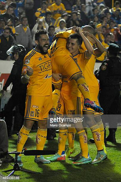 Damian Alvarez of Tigres celebrates with teammates after scoring the winning goal during a match between Tigres UANL and Toluca as part of 17th round...