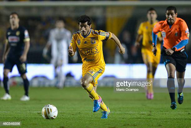 Damian Alvarez of Tigres drives the ball during a Final first leg match between Tigres UANL and America as part of the Apertura 2014 Liga MX at...