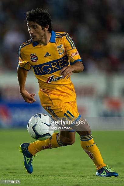 Damian Alvarez of Tigres drives the ball during a match between Pachuca and Tigres as part of the Apertura 2013 mexican soccer league at Hidalgo...