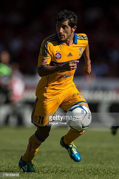 Damian Alvarez of Tigres drives the ball during a match between Veracruz and Tigres as part of the Apertura 2013 Liga MX at Luis Pirata Fuente...