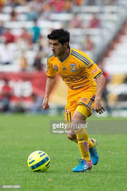 Damian Alvarez of Tigres drives the ball during a match between Leones Negros and Tigres UANL as part of 9th round Clausura 2015 Liga MX at Jalisco...
