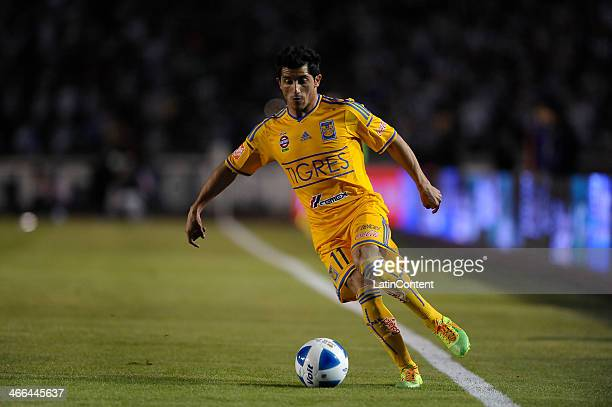 Damian Alvarez of Tigres drives the ball during a match between Monterrey and Tigres UANL as part of the Clausura 2014 Liga MX at Tecnologico Stadium...