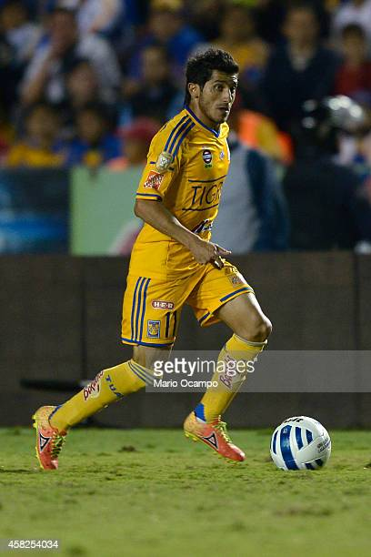 Damian Alvarez of Tigres drives the ball during a match between Tigres UANL v Queretaro as part of 15th round Apertura 2014 Liga MX at Universitario...