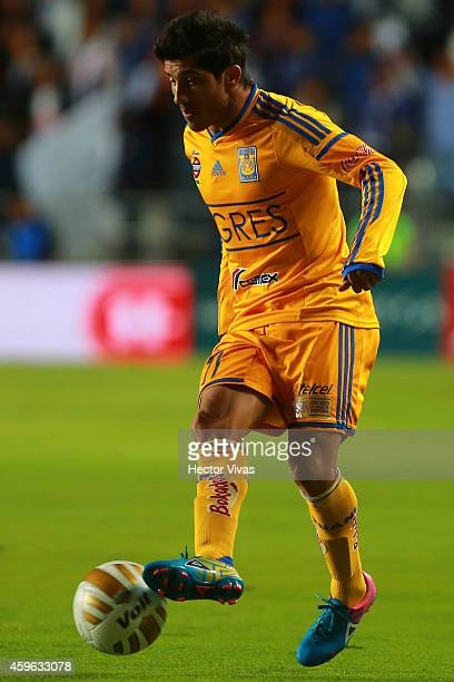 Damian Alvarez of Tigres drives the ball during a quarterfinal first leg match between Pachuca and Tigres as part of the Apertura 2014 Liga MX at...