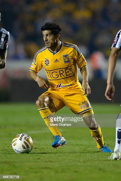 Damian Alvarez of Tigres drives the ball during a quarterfinal second leg match between Tigres UANL and Pachuca as part of the Apertura 2014 Liga MX...
