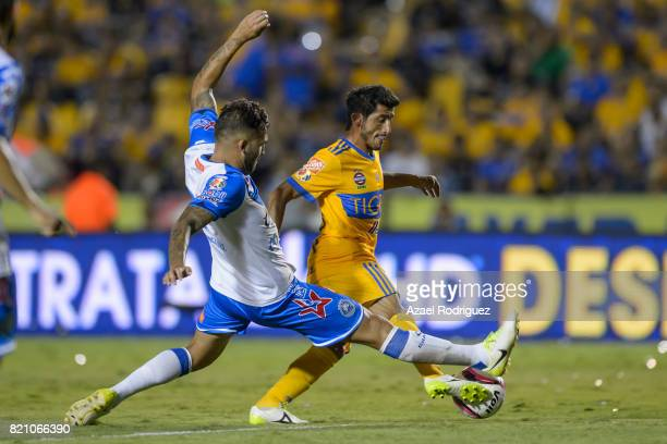 Damian Alvarez of Tigres fights for the ball with Pablo Miguez of Puebla during the 1st round match between Tigres UANL and Puebla as part of the...