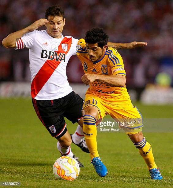 Damian Alvarez of Tigres fights for the ball with Rodrigo Mora of River Plate during a match between River Plate and Tigres as part of second round...