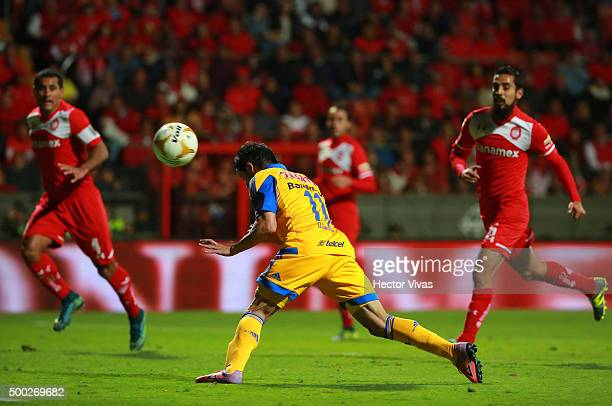 Damian Alvarez of Tigres heads the ball to score the second goal of his team during the semifinals second leg match between Toluca and Tigres UANL as...